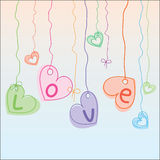 Hearts hanging on strings Stock Photo