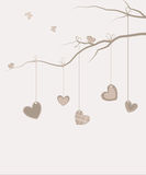 Hearts hanging on a tree branch. Vector festive background Valentine`s Day. Vintage. Template for postcards. Hearts hanging on a tree branch Royalty Free Stock Photography