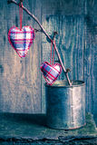 Hearts hanging twig tin box Royalty Free Stock Photos