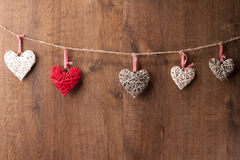 Hearts hanging on wooden wall Stock Photo