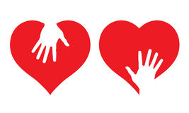 Hearts with helping hands Stock Photo