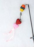Hearts on hook. Fishing rod hook two red and pink hearts Stock Photography