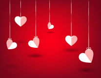 Hearts hunging in a red background. Love background template Royalty Free Stock Photos