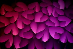 Hearts I. N different colors on a black background Royalty Free Stock Images