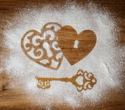 Hearts and a key of the flour as a symbol of love on wooden background. Valentines day background. Vintage retro card.