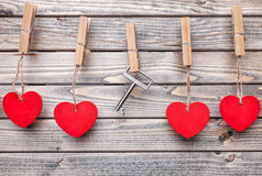 Hearts and key hanging on a string Royalty Free Stock Images
