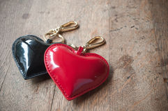 Hearts Key ring black and red on wooden background stock photography