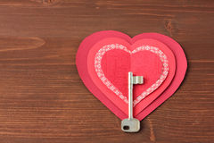 Hearts and key on wooden Stock Photography