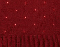 Hearts on knitted wool background Stock Photography