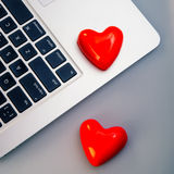 Hearts and laptop Royalty Free Stock Photos