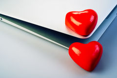 Hearts and laptop Stock Photo