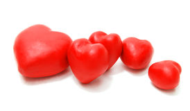 Hearts Laying Random. Valentine's 3D Red Hearts Laying Random Made of Clay Isolated on White Background Stock Photo