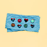Hearts and lemons on blue paper. Royalty Free Stock Photos