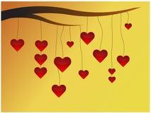 Hearts on limb. Red hearts hanged on limb Royalty Free Stock Image