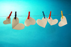 Hearts on the line. Paper hearts on a miniature clothes line, symbolizing putting your heart on the line Royalty Free Stock Images