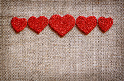 Hearts line on canvas Stock Photos