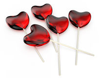 Hearts lollipops. Valentine's Day celebration concept: red glossy shiny lolipops in the form of hearts  isolated on white background Stock Images