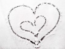 Hearts of lovers in the snow. Hearts symbol of love. Valentine`s Day Royalty Free Stock Photography