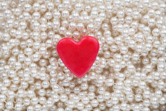 Hearts lying on the white beads Royalty Free Stock Images