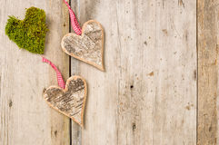 Hearts made of bark on a wooden background Stock Images
