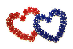 Hearts made of chips. Creative chips; red and blue hearts made of poker chips isolated over white Royalty Free Stock Image
