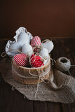 Hearts made of cloth. With red white checkered pattern on rustic old wood with copy space, concept of love at Christmas, Mother's Day or Valentine's Day Royalty Free Stock Photos