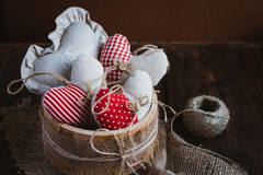 Hearts made of cloth. With red white checkered pattern on rustic old wood with copy space, concept of love at Christmas, Mother's Day or Valentine's Day Royalty Free Stock Images