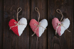 Hearts made of cloth. With red white checkered pattern on rustic old wood with copy space, concept of love at Christmas, Mother's Day or Valentine's Day Stock Photography