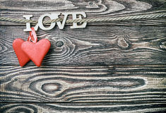 Hearts made of felt and the word love made Royalty Free Stock Photography