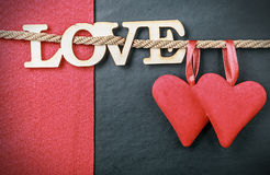 Hearts made of felt and the word love made of wood Stock Image