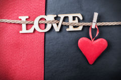 Hearts made of felt and the word love Royalty Free Stock Photo