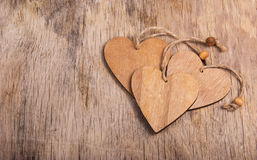 Hearts made of wood in the old worn wooden background. Wooden valentine. Valentine`s day. Copy space. Hearts made of wood in the old worn wooden background Stock Photo