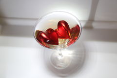 Hearts in a martini glass Royalty Free Stock Image