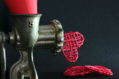 Hearts from a meat grinder Stock Photos