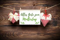 2 hearts with a message saying `Happy Mother`s Day`. In German stock image