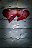 Hearts on metal door background Royalty Free Stock Images
