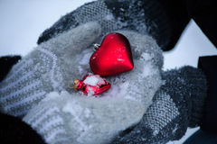 Hearts, mittens, snow, love. Lovers man and woman in mittens to keep hands, hearts and snow Royalty Free Stock Photography