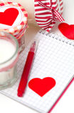 Hearts, notebooks and candles Stock Photo