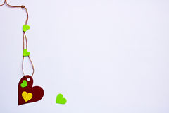 Hearts - one larger with five small,, spliced rope,copy space Royalty Free Stock Photo