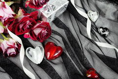Hearts over Black Textile Still Life Stock Photo