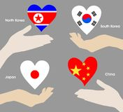 Hearts over hands as the flags of China, North Korea, South Korea, Japan. A symbol of patriotism and love. Royalty Free Stock Image