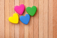 Hearts over a wooden background Stock Image