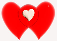 Family of hearts. 2 overlapping red hearts with a white heart shared Royalty Free Stock Photo
