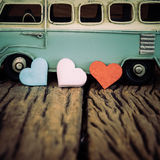 Hearts with part of vintage blue van background on old wooden ta Stock Photo