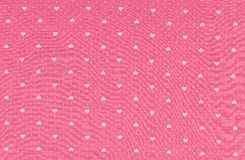 Hearts pattern on fabric texture background. Royalty Free Stock Photography