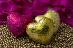 Hearts with pearl decorations around them Royalty Free Stock Image