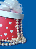 Hearts & Pearls. Pearl necklace spilling out of heart box Royalty Free Stock Image