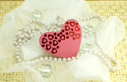 Hearts, pebbles, woven cloth on wood Royalty Free Stock Photos