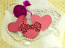 Hearts, pebbles, woven cloth on wood Stock Photos