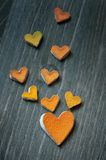 Hearts from the peel of citrus. Fruit on a wooden board Stock Photo